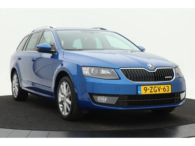 Skoda Octavia Combi 1.6 TDI Business | Xenon | Keyless | Groot navigatie | Stoelverwarming | Privacy glass | Lichtmetalen velgen | Trekhaak