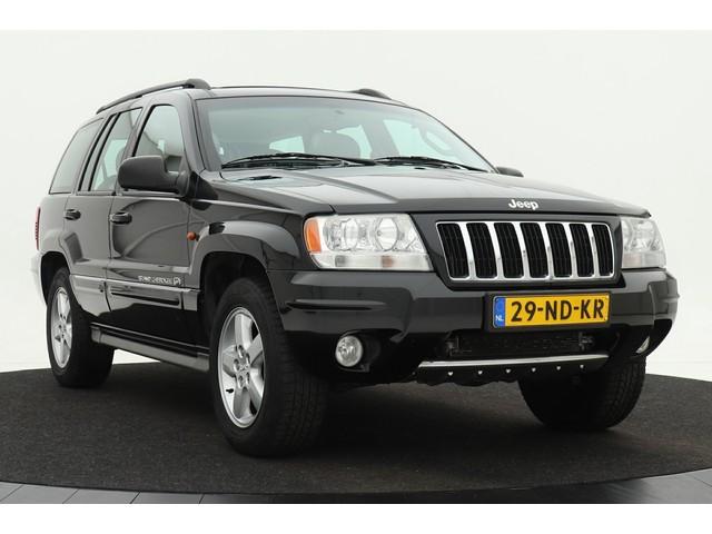 Jeep Grand Cherokee 4.7i V8 Overland High Output *Youngtimer* | Navigatie | Schuif- kanteldak | Climate control | Cruise control | Volleder | Trekh