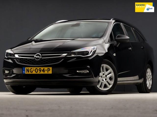 Opel Astra Sports Tourer 1.0 Sport Edition (APPLE CARPLAY, NAVIGATIE, TREKHAAK, XENON, SPORTSTOELEN, PARKEERSENS,  ISOFIX, ELEK PAKKET, CRU